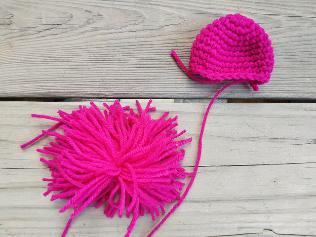 crochetbug, crochet ball, ideal crochet sphere, pom pom, fuchsia yarn