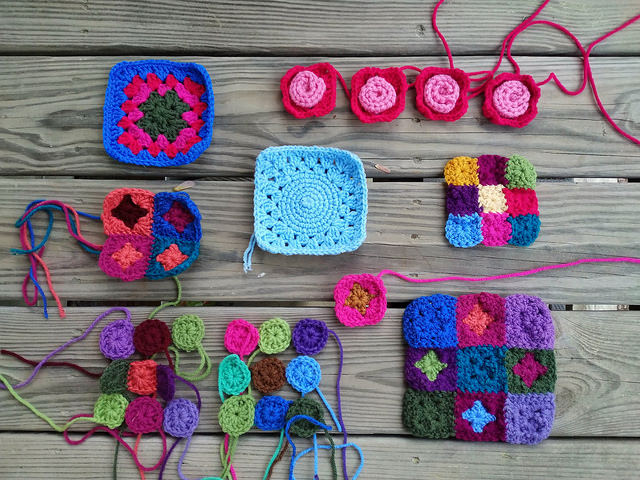 crochet remnants with some seams joined and ends woven in on their way to be rehabbed into five and six inch crochet squares