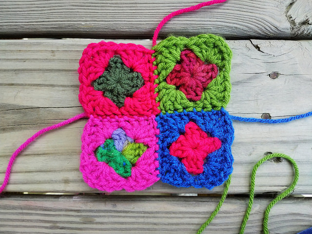 After threading the needle, I join four two-round granny squares into one square