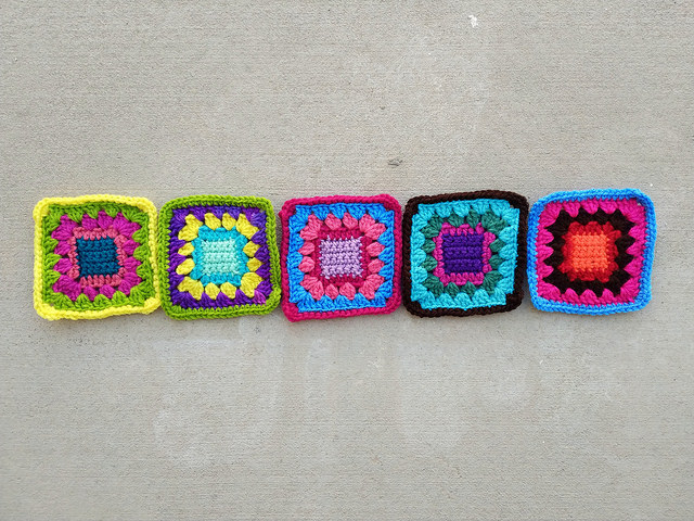 Five crochet remnants transformed into five-inch crochet squares completed while on the edge of a time vortex