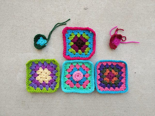 Four of the six crochet remnants rehabbed into five-inch crochet squares