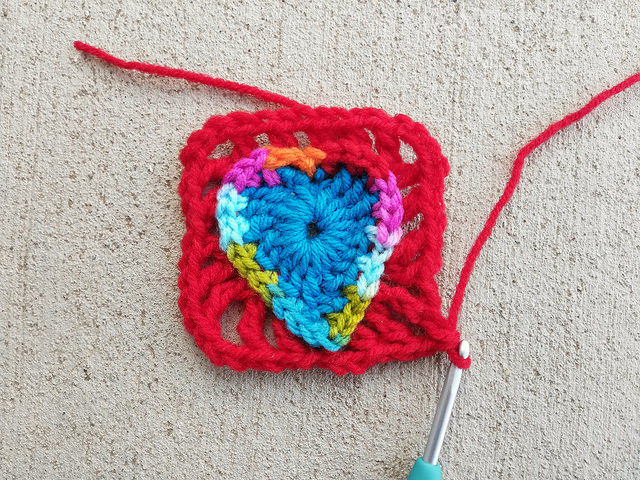 The first round of the squaring off of a two round boho crochet heart