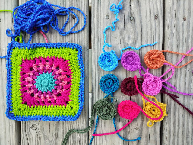 Nine more crochet circles for a future crochet purse shown with the square they are destined to become