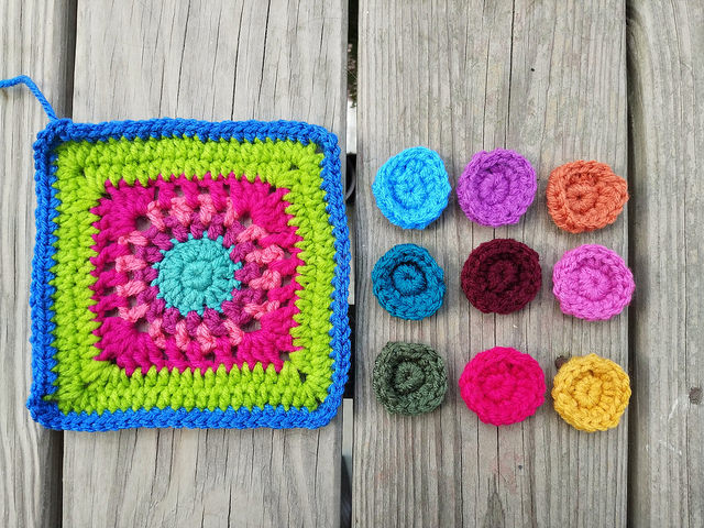 Weaving in ends for nine of the addition twelve crochet circles needed for a new crochet purse