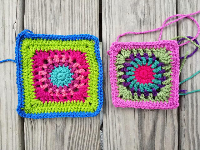 A variation on crochet square c-2 next to a variation on a  variation that demonstrates what you can accomplish when you let a baseball game be your umbrella