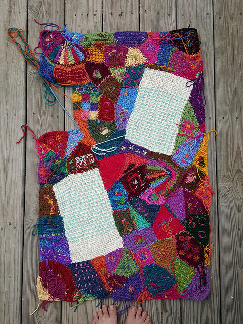 The back of the crochet center panel with many of the ends woven in and ready to be trimmed