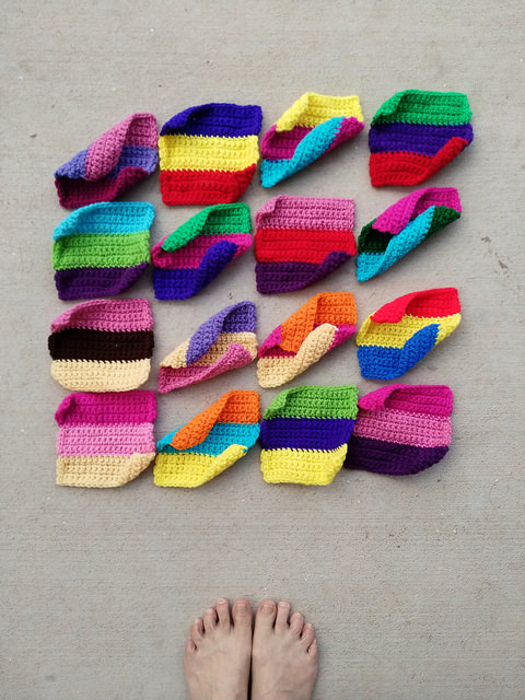 Sixteen crochet squares in need of just a touch more crochet rehab
