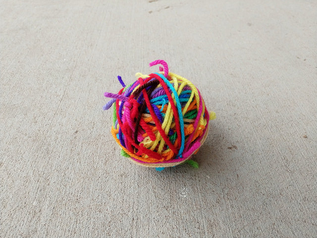 The scrap yarn ball with many of the previous yarn ends added to it demonstrating the inherent interconnectedness of crochet