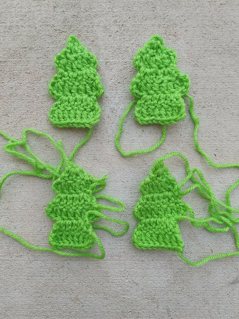 Four future crochet Christmas trees for a Gingerbread House Tissue Box cozy