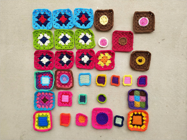 Progress on thirty-three future crochet squares fashioned from crochet remnants