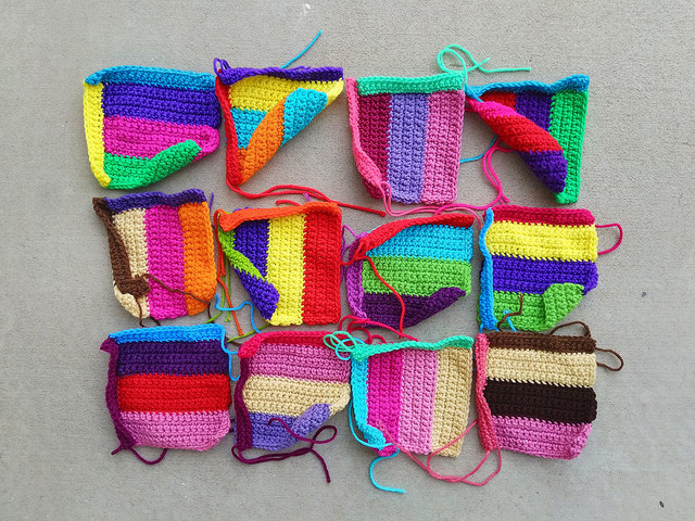Twelve of sixteen future television test strip crochet squares in the middle of my journey to one thousand squares
