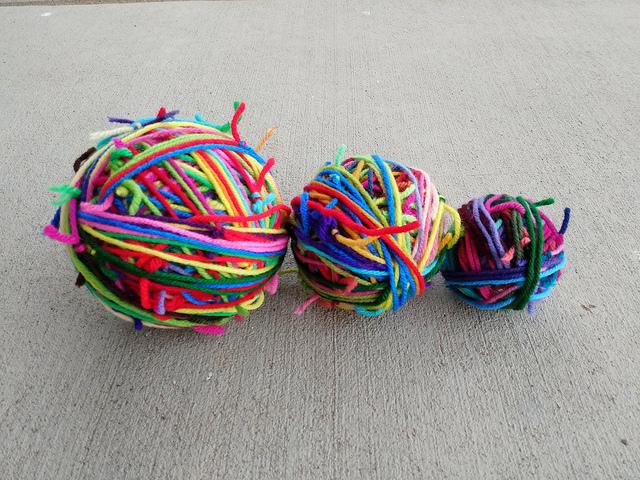 Three magic balls of scrap yarn