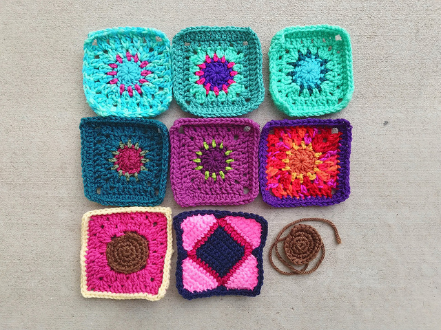 Eight of nine crochet remnants rehabbed and ready for adventure