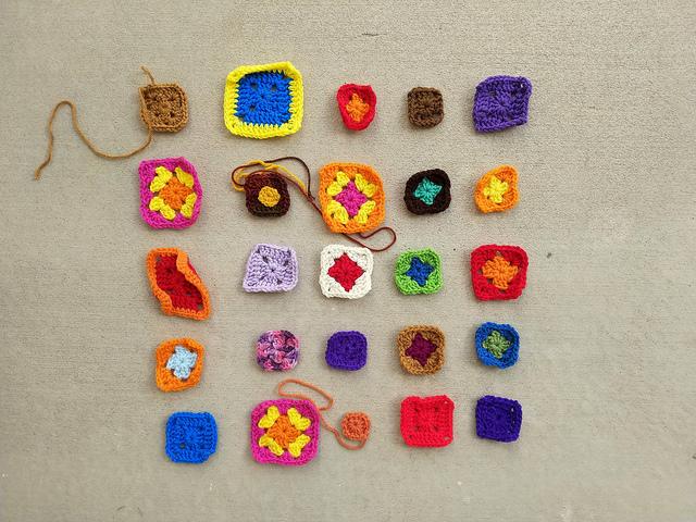 Twenty-five granny square crochet remnants