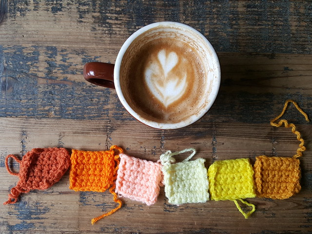 Six crochet squares and half of a double flat white