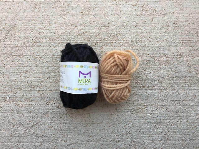 Two neutral skeins of yarn