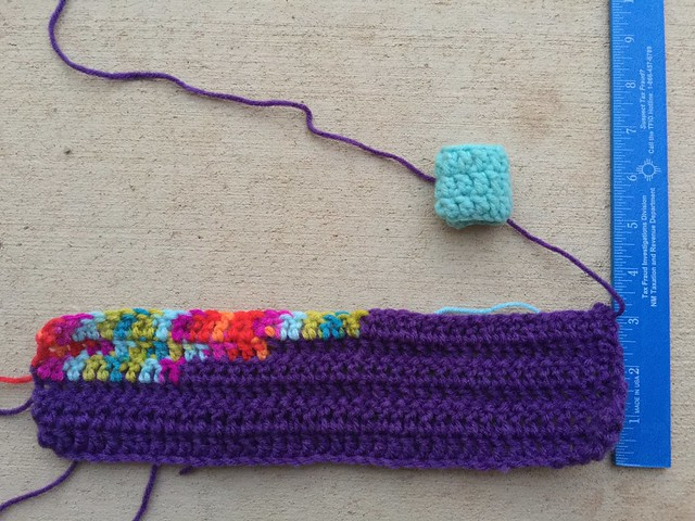 Checking the stitch height of a Day of the Dead yarn bomb panel
