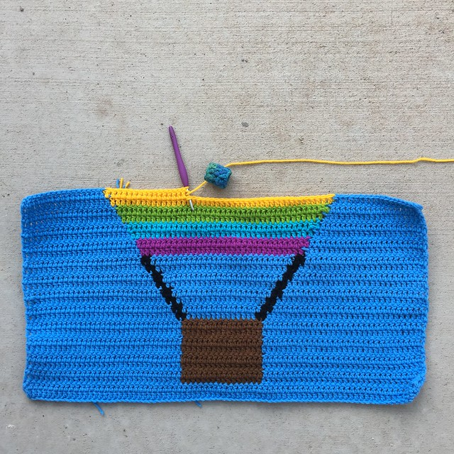 This was how far I had gotten with the first panel of my balloon inspired crochet yarn bomb