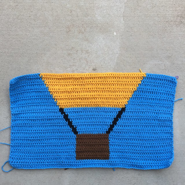 A solid yellow crochet hot air balloon panel
