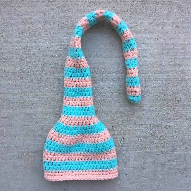 A aqua and light coral striped crochet munchkin hat