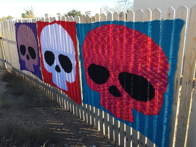 Three Day of the Dead sugar skull crochet yarn bombs