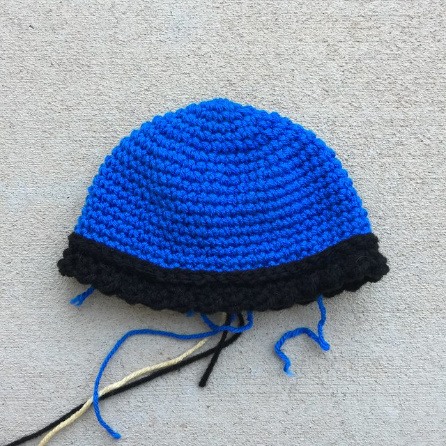 A second crochet Viking helmet worked in blue and black yarn