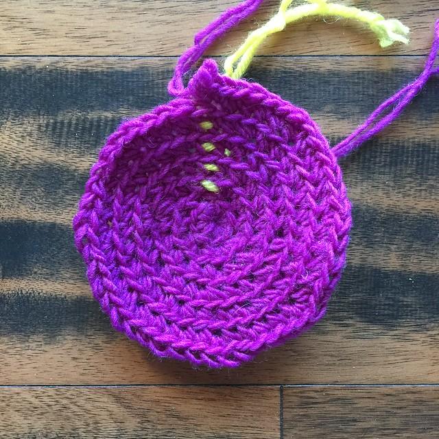A purple crochet cozy to use under an oil cruet