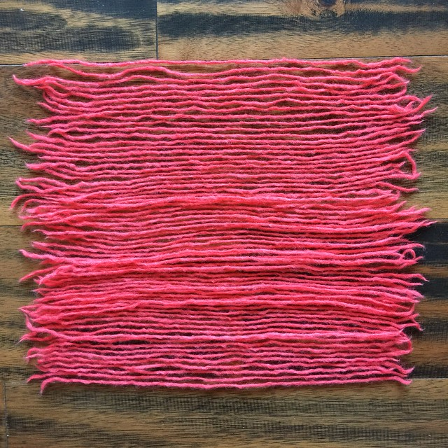 Yarn dyed pink for the llama's fringe laid out to dry