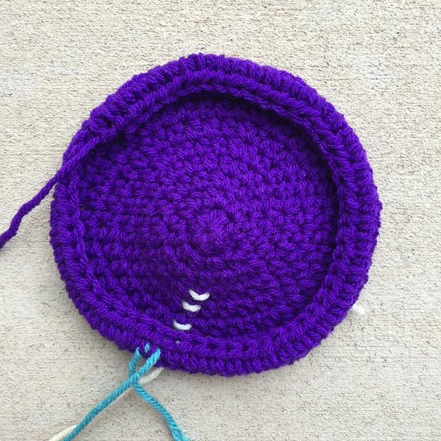 A new crochet troll hat made with purple yarn