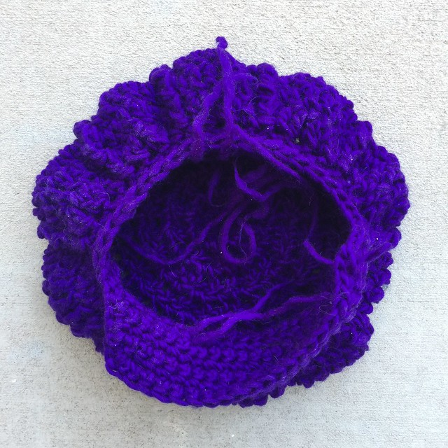 A purple crochet newsboy hat with ends still to be woven in after a busy crochet weekend