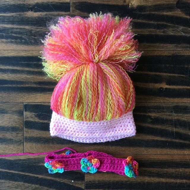 The base of the crochet troll hat with the flowered headband to be attached