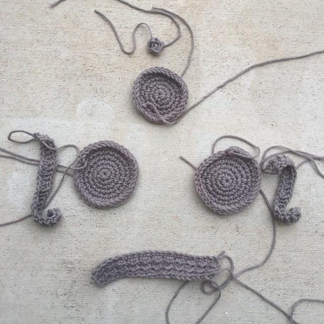 Gray crochet pieces for a crochet Viking helmet