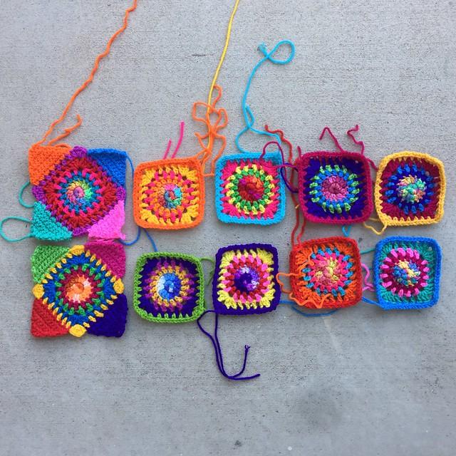 Ten almost done multicolor granny squares for ten crochet square washable bag