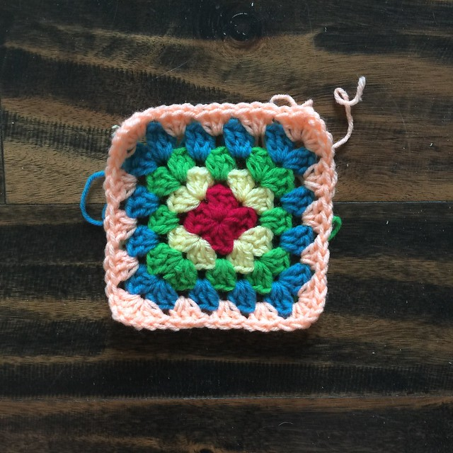 Five rounds in on what will be a thirty-six round multicolor great granny square blanket