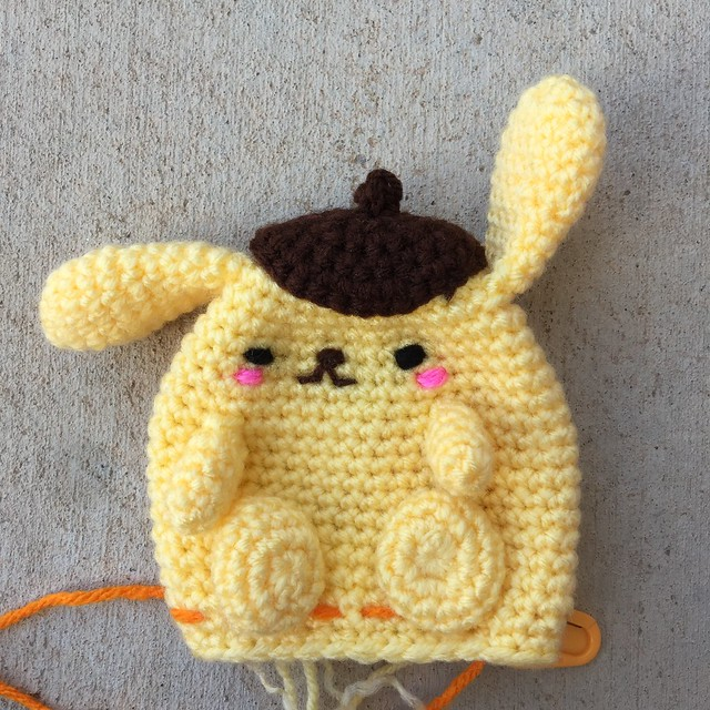 With his crochet paws all attached, Purin comes to life