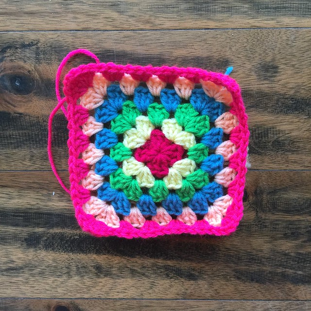 Six rounds in on what will be a thirty-six round multicolor great granny square blanket