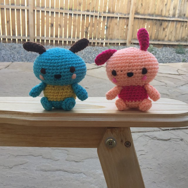 Two crochet Pochacco's enjoying a blustery crochet day on the patio
