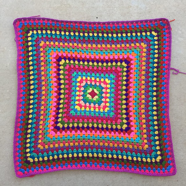 Thirty-three rounds of a great granny square multicolor crochet blanket