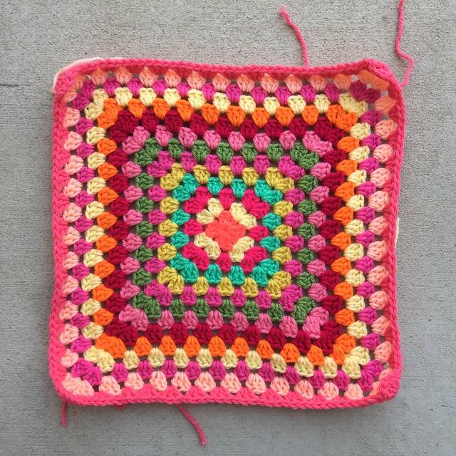 A multicolor crochet granny square blanket for a baby