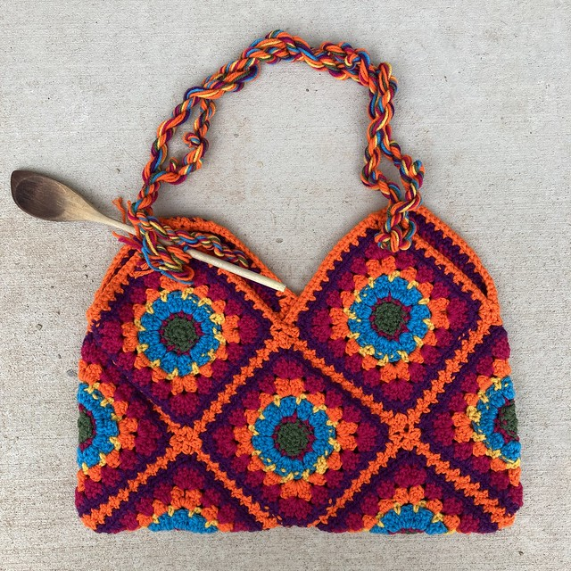 A nearly completed crochet pandemic purse