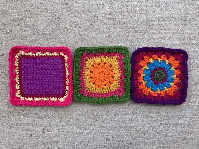 Three multicolor crochet granny squares
