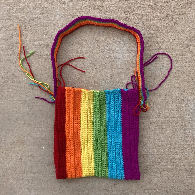 The body of a rainbow purse with a coordinating strap