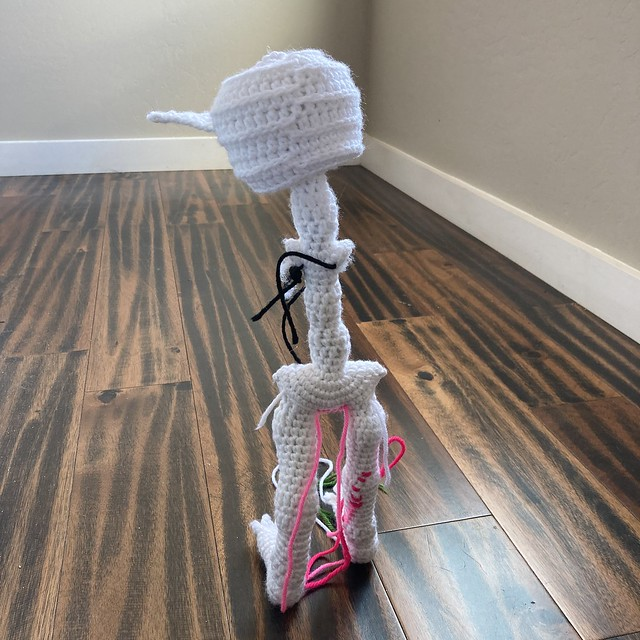 Mr. Headz the amigurumi skeleton takes off in search of his arms