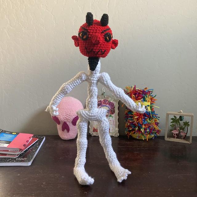 The crochet devil in his workshop