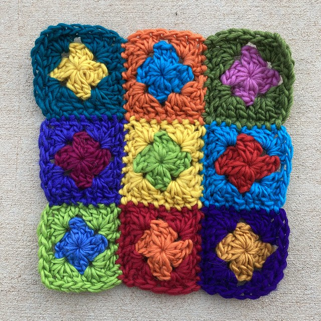 nine two-round granny squares joined and ready for felting