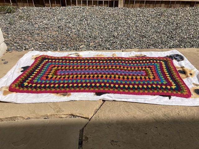 """A multicolor crochet granny rectangle rug getting some """"vitamin sunshine"""""""