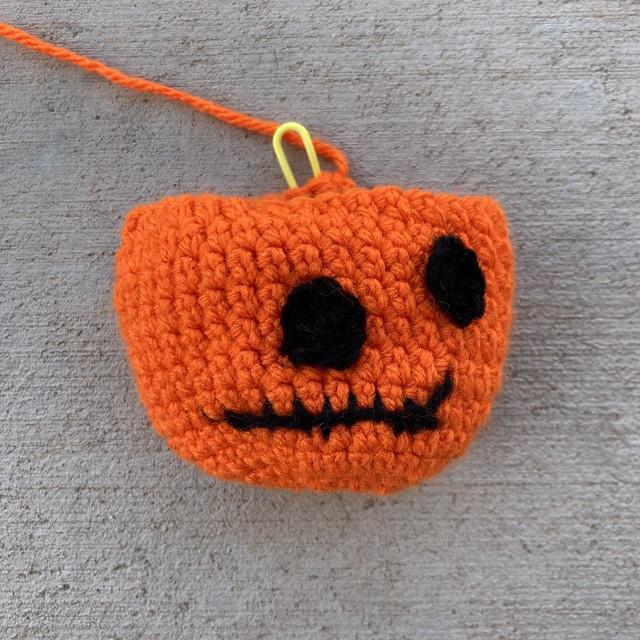 A crochet pumpkin head for 2020 Halloween