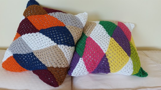 two triangle cushions one resting on other