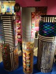 9-Foot high knitted shawls and quilts cover the columns.