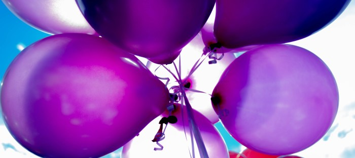 Photo of various colored balloon tied together